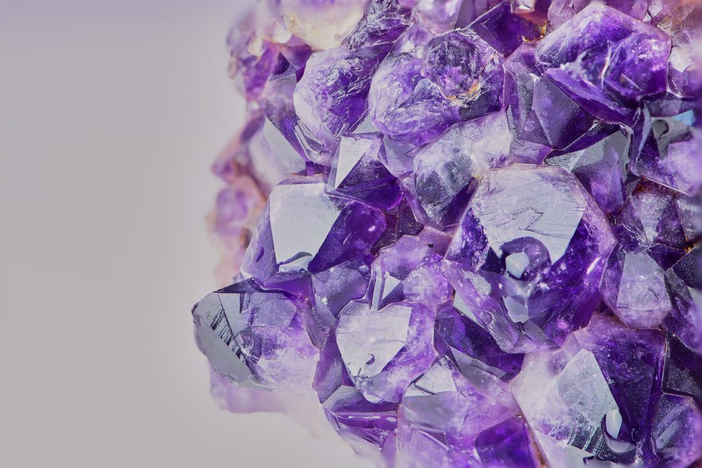macro color photo of amethyst with focus stacking against white background